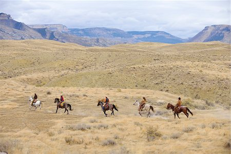 Cowboys and Cowgirls riding horse in wilderness, Rocky Mountains, Wyoming, USA Stock Photo - Premium Royalty-Free, Code: 600-08171755
