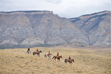 Cowboys and Cowgirls riding horse in wilderness, Rocky Mountain, Wyoming, USA Stock Photo - Premium Royalty-Free, Code: 600-08171753