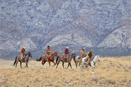 Cowboys and Cowgirls riding horses in wilderness, Rocky Mountains, Wyoming, USA Stock Photo - Premium Royalty-Free, Code: 600-08171768