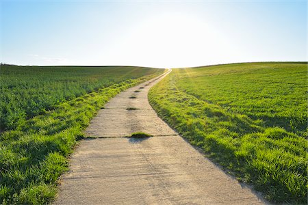 roads and sun - Road through Field with Sun, Helmstadt, Franconia, Bavaria, Germany Stock Photo - Premium Royalty-Free, Code: 600-08232272