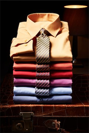 elegant - Stack of shirts with ties on suitcase in studio Stock Photo - Premium Royalty-Free, Code: 600-08312066