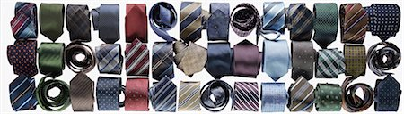 Assortment of ties rolled-up on white background in studio Stock Photo - Premium Royalty-Free, Code: 600-08312068