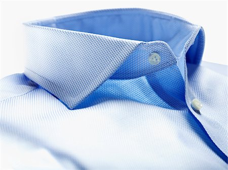 Detail of collar of blue shirt on white background in studio Stock Photo - Premium Royalty-Free, Code: 600-08312062