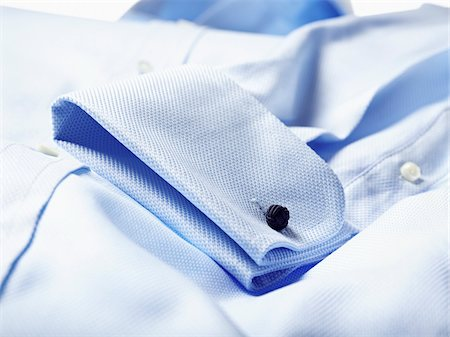 Detail of cuff of blue shirt in studio Stock Photo - Premium Royalty-Free, Code: 600-08312063