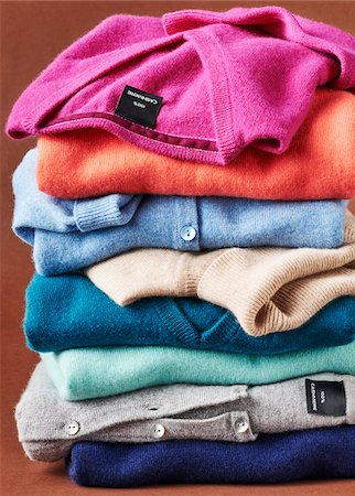 Stack of multicolored cashmere pullover sweters in studio Stock Photo - Premium Royalty-Free, Code: 600-08312073