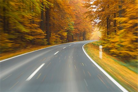 forward - Road View from a Scenic Route in Autumn Forest, Spessart, Franconia, Bavaria, Germany Stock Photo - Premium Royalty-Free, Code: 600-08353457