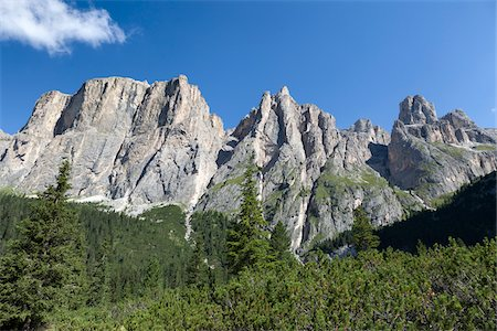 spike - Scenic view of mountains with rocky towers at the beginning of the Lastes valley, a wild and uncrowded place into the heart of the massif of Sella, Dolomites, Trentino Alto Adige, Italy Stock Photo - Premium Royalty-Free, Code: 600-08386021