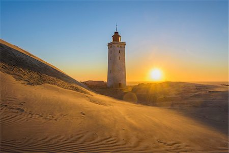 Lighthouse and Dunes, Rubjerg Knude at Sunset, Lokken, North Jutland, Denmark Fotografie stock - Premium Royalty-Free, Codice: 600-08512544