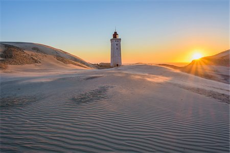 streams scenic nobody - Lighthouse and Dunes, Rubjerg Knude at Sunset, Lokken, North Jutland, Denmark Stock Photo - Premium Royalty-Free, Code: 600-08512546