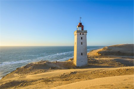Lighthouse and Dunes, Rubjerg Knude, Lokken, North Jutland, Denmark Photographie de stock - Premium Libres de Droits, Code: 600-08512541
