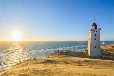 Lighthouse and Dunes, Rubjerg Knude at Sunset, Lokken, North Jutland, Denmark Stock Photo - Premium Royalty-Free, Code: 600-08512542
