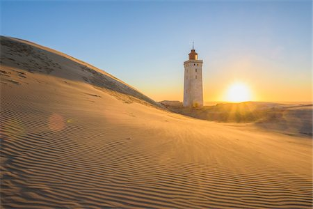 Lighthouse and Dunes, Rubjerg Knude at Sunset, Lokken, North Jutland, Denmark Fotografie stock - Premium Royalty-Free, Codice: 600-08512543