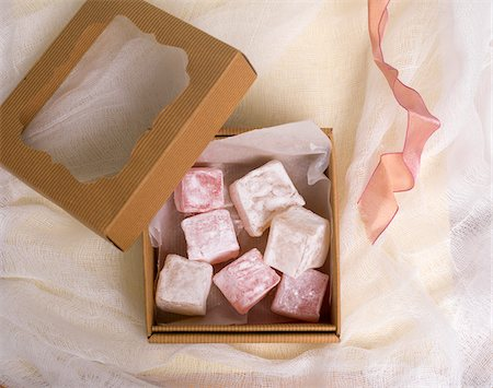 sweet - Overhead View of Open Gift Box of Turkish Delight with Ribbon Stock Photo - Premium Royalty-Free, Code: 600-08512597