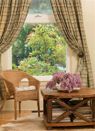 quaint house - Chair and Coffee Table with Flowers by Window with Drapes in Living Room Stock Photo - Premium Royalty-Free, Code: 600-08512607