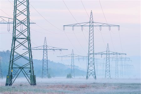 Electricity Pylons in Morning Mist, Hesse, Germany Stock Photo - Premium Royalty-Free, Code: 600-08548021