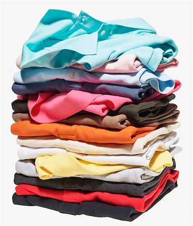 Stack of different coloured polo shirts on white background Stock Photo - Premium Royalty-Free, Code: 600-08542887