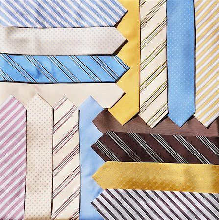 silky - Group of pastel colored neckties, layered and overlapping, studio shot Stock Photo - Premium Royalty-Free, Code: 600-08542880
