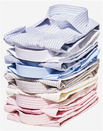 Stack of different coloured shirts on white background Stock Photo - Premium Royalty-Free, Code: 600-08542894