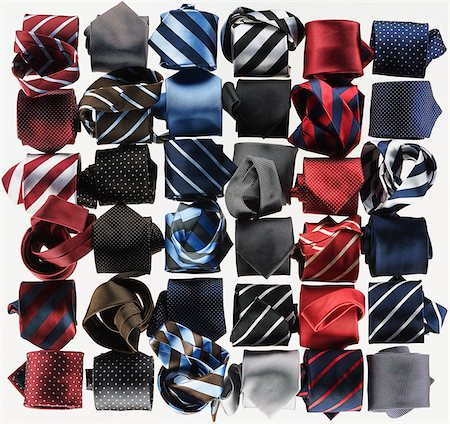 simsearch:400-04638538,k - Group of necktie roled-up on white background Stock Photo - Premium Royalty-Free, Code: 600-08542895