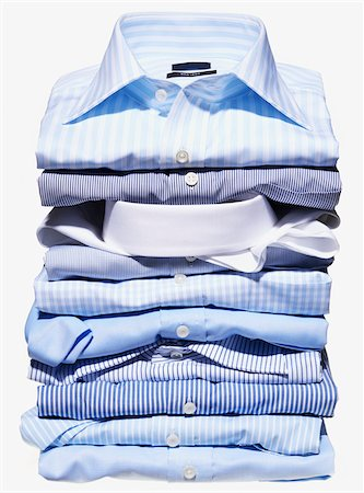 Stack of multi coloured shirts on white background Stock Photo - Premium Royalty-Free, Code: 600-08542892