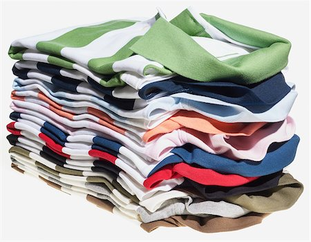 Stack of striped polo shirts on white background Stock Photo - Premium Royalty-Free, Code: 600-08542907