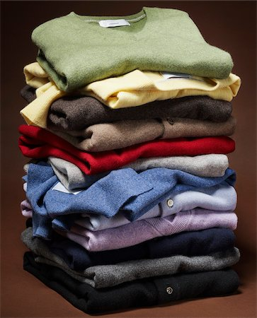 Stack of multi coloured cashmere sweaters on brown background Stock Photo - Premium Royalty-Free, Code: 600-08542908