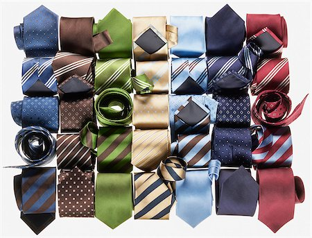 Group of multi coloured neckties roled-up on white background Stock Photo - Premium Royalty-Free, Code: 600-08542915