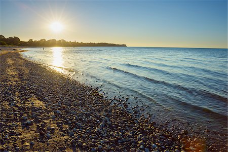 Pebble beach with Sun in Summer, Sunset, Dronningmolle, Hovedstaden, Baltic Sea, Zealand, Denmark Stock Photo - Premium Royalty-Free, Code: 600-08578850