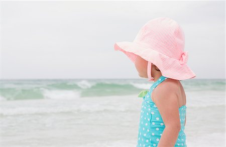 Portrait of Toddler Girl wearing Sunhat on Beach and Looking out at Ocean, Destin, Florida, USA Stock Photo - Premium Royalty-Free, Code: 600-08657513
