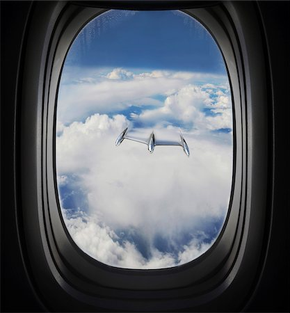 View of Approaching UFO from Airplane Window Stock Photo - Premium Royalty-Free, Code: 600-08697965