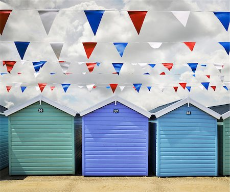 pennant flag - Row of Beach Huts and Pennant Flags in Weston Super Mare, England, UK Stock Photo - Premium Royalty-Free, Code: 600-08697966