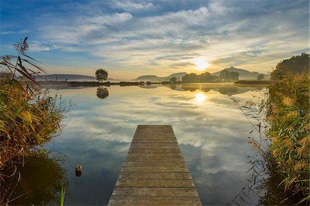Wooden Jetty with Reflective Sky in Lake at Sunrise, Drei Gleichen, Ilm District, Thuringia, Germany Stock Photo - Premium Royalty-Free, Code: 600-08723093