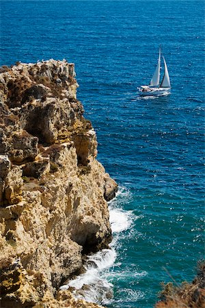portuguese (places and things) - Sailboat and Cliffs at Lagos, Algarve Coast, Portugal Stock Photo - Premium Royalty-Free, Code: 600-08770147