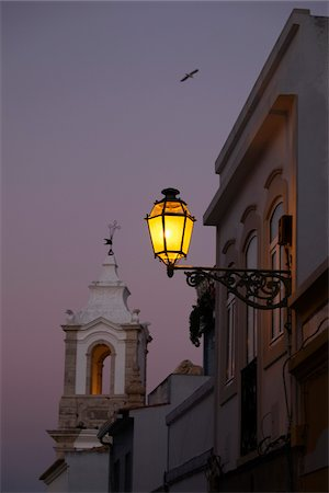 portuguese (places and things) - Bell Tower of Igreja de Santo Antonio and Street Lamp at Dusk, Lagos, Portugal Stock Photo - Premium Royalty-Free, Code: 600-08770149