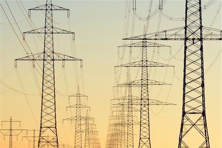 Electricity Pylons at Sunset, Hesse, Germany Stock Photo - Premium Royalty-Free, Code: 600-08797098