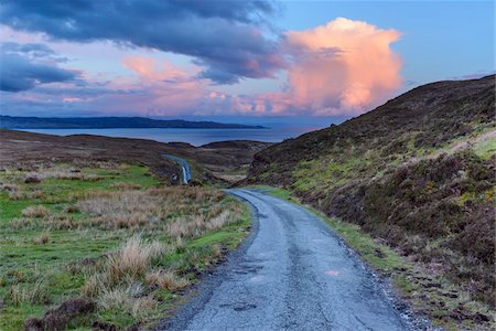 simsearch:845-03720933,k - Old winding single track road in spring with cumulonimbus clouds at sunset on the Isle of Skye in Scotland, United Kingdom Stock Photo - Premium Royalty-Free, Code: 600-08986299