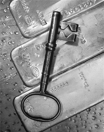 Close-Up of Skeleton Key and Ingots Stock Photo - Premium Royalty-Free, Code: 600-00024075