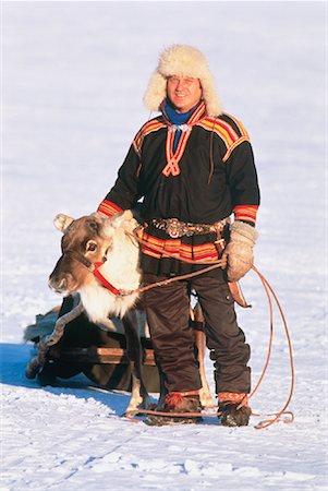 Laplander and Reindeer Near Jukkasjarvi Lapland, Sweden Stock Photo - Premium Royalty-Free, Code: 600-00025966