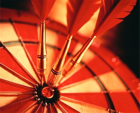 Close-Up of Darts in Bull's-Eye Of Dartboard Stock Photo - Premium Royalty-Free, Code: 600-00034286