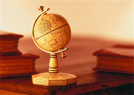 Globe on Stand on Desk with Books Stock Photo - Premium Royalty-Free, Code: 600-00046594