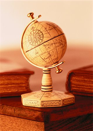 Globe on Stand on Desk with Books Stock Photo - Premium Royalty-Free, Code: 600-00046595