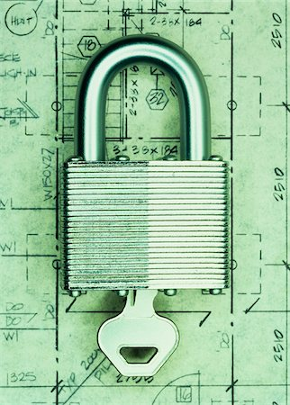 Key in Padlock on Floor Plans Stock Photo - Premium Royalty-Free, Code: 600-00055192
