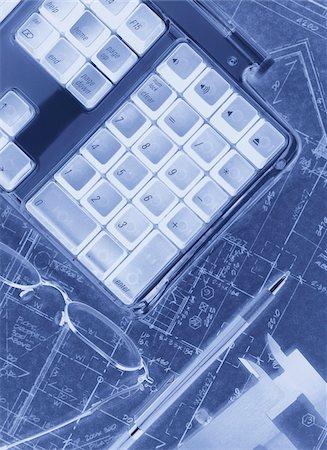 Computer Keyboard and Eyeglasses on Blueprints Stock Photo - Premium Royalty-Free, Code: 600-00056505
