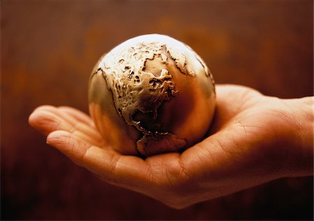 Globe in Palm of Hand North America Stock Photo - Premium Royalty-Free, Code: 600-00057099