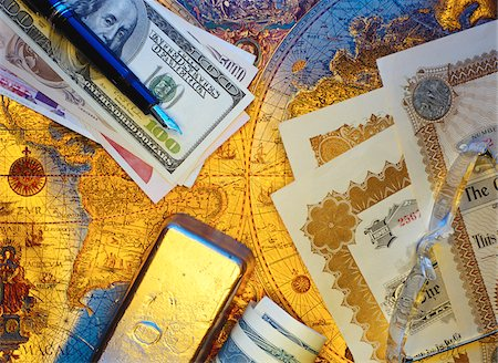 International Currency, Pen Stock Certificates and Gold Bar On Antique World Map Stock Photo - Premium Royalty-Free, Code: 600-00065082