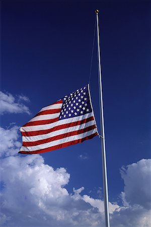 flag at half mast - American Flag at Half Mast with Clouds in Sky Stock Photo - Premium Royalty-Free, Code: 600-00067519