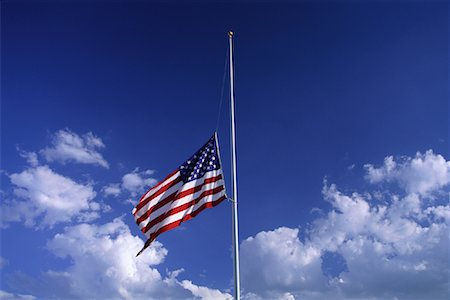 flag at half mast - American Flag at Half Mast with Clouds in Sky Stock Photo - Premium Royalty-Free, Code: 600-00067520
