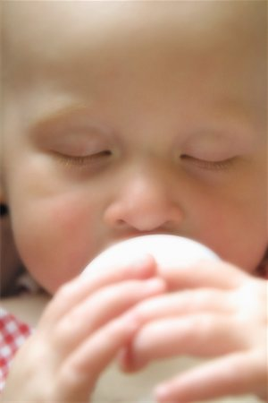 Close-Up of Baby Drinking from Bottle Stock Photo - Premium Royalty-Free, Code: 600-00061589