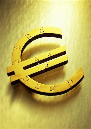 Gold Euro Symbol as Jigsaw Puzzle Stock Photo - Premium Royalty-Free, Code: 600-00077464