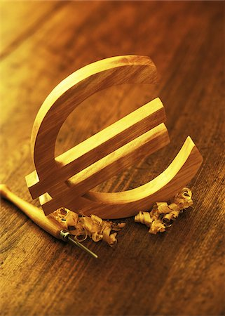 symbol - Wooden Euro Symbol and Carving Tool Stock Photo - Premium Royalty-Free, Code: 600-00077467